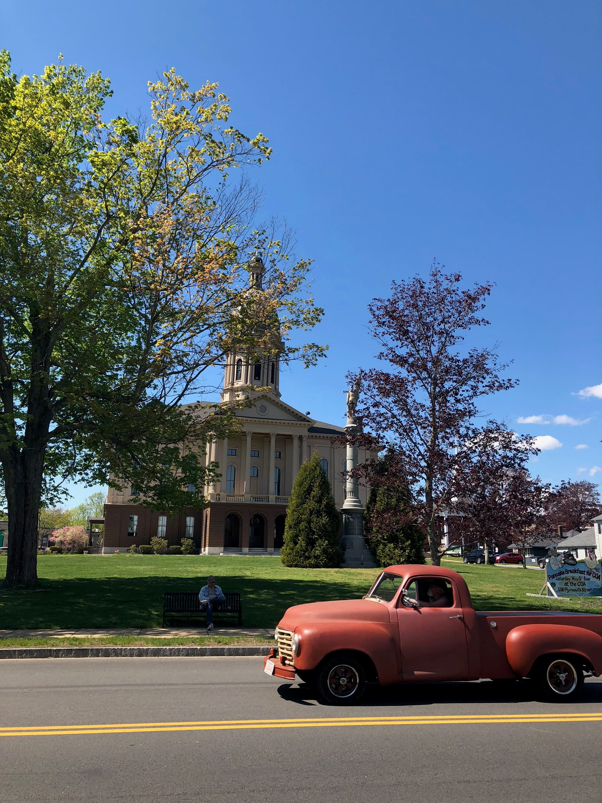 front view of town hall with old truck